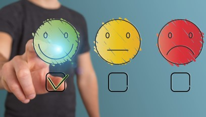 Man pressing smiley face feedback button